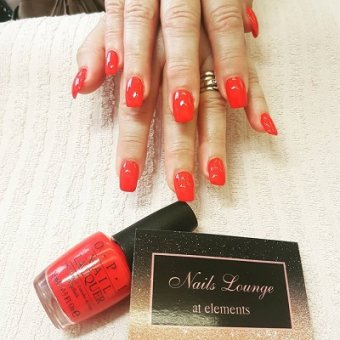 red acrylic nails at the Nails Lounge in Bishop's Stortford